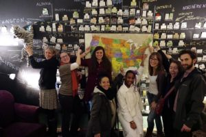 group of students in front of map of North America showing many POCA clinics